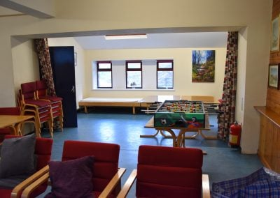 Extended lounge area with 2 accessible beds